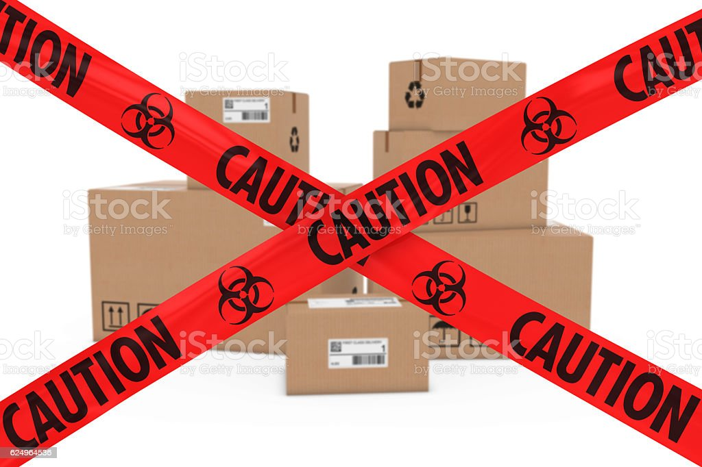 Stack of Cardboard Boxes behind Caution Biohazard Tape Cross stock photo