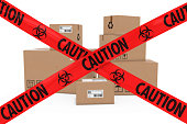 Stack of Cardboard Boxes behind Caution Biohazard Tape Cross