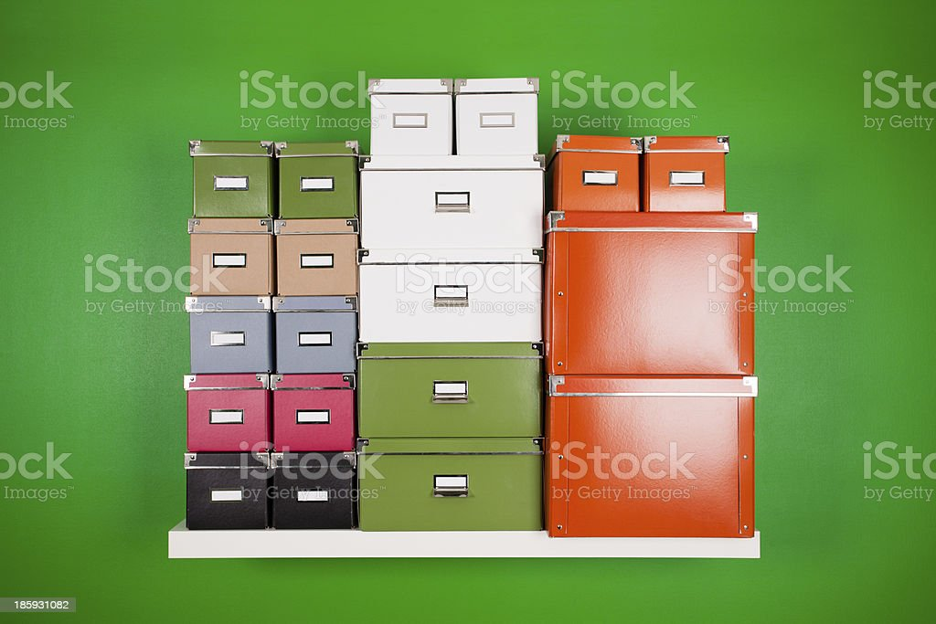 stack of cardboard colored boxes stock photo