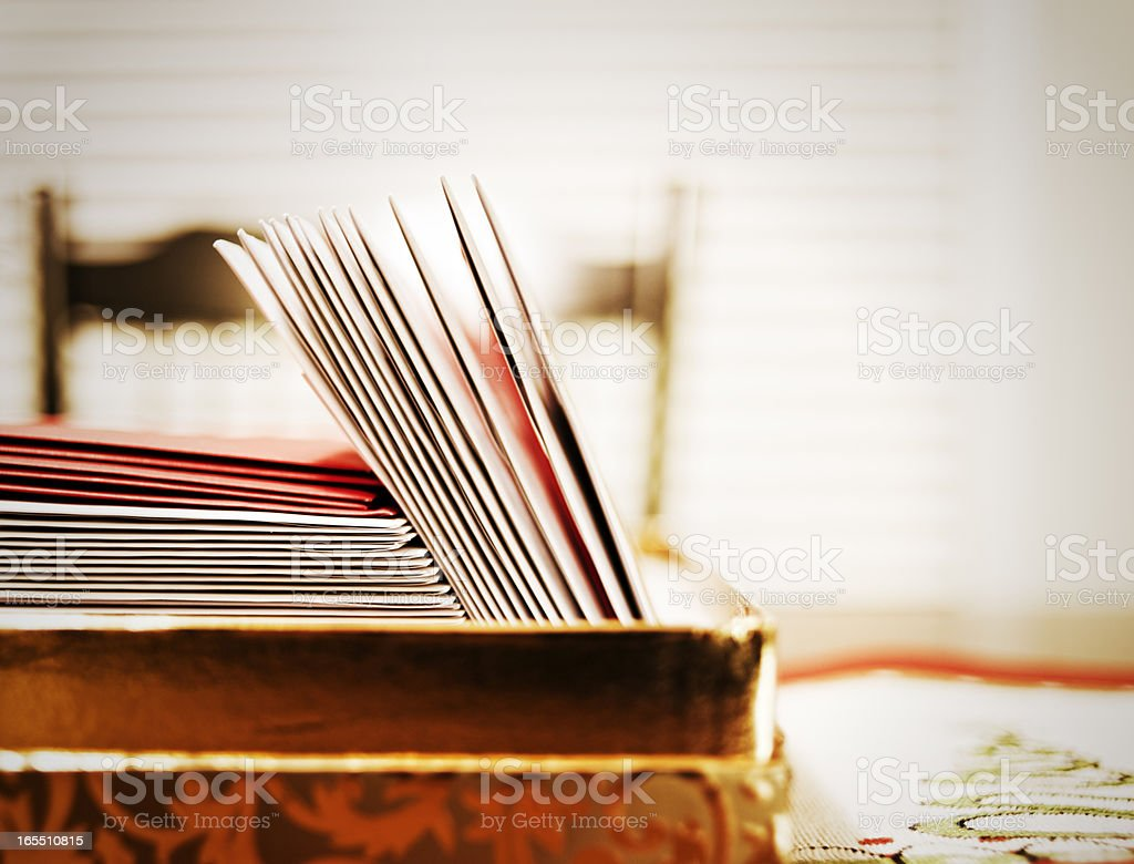 Stack of cards in a box on a table stock photo
