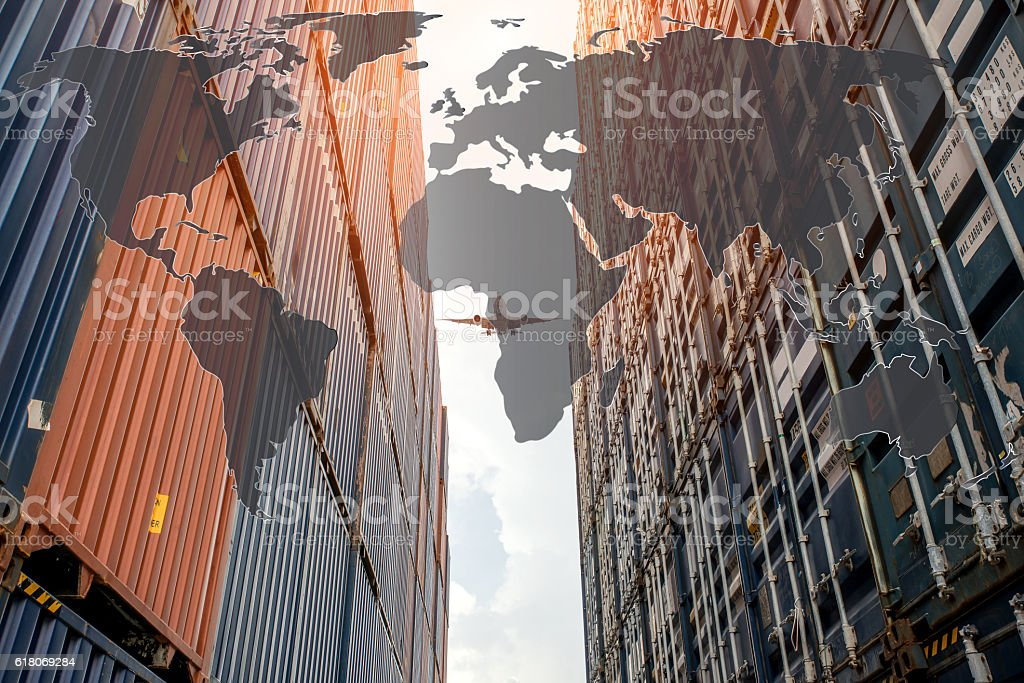 Stack of cargo containers with global map at the docks. stock photo