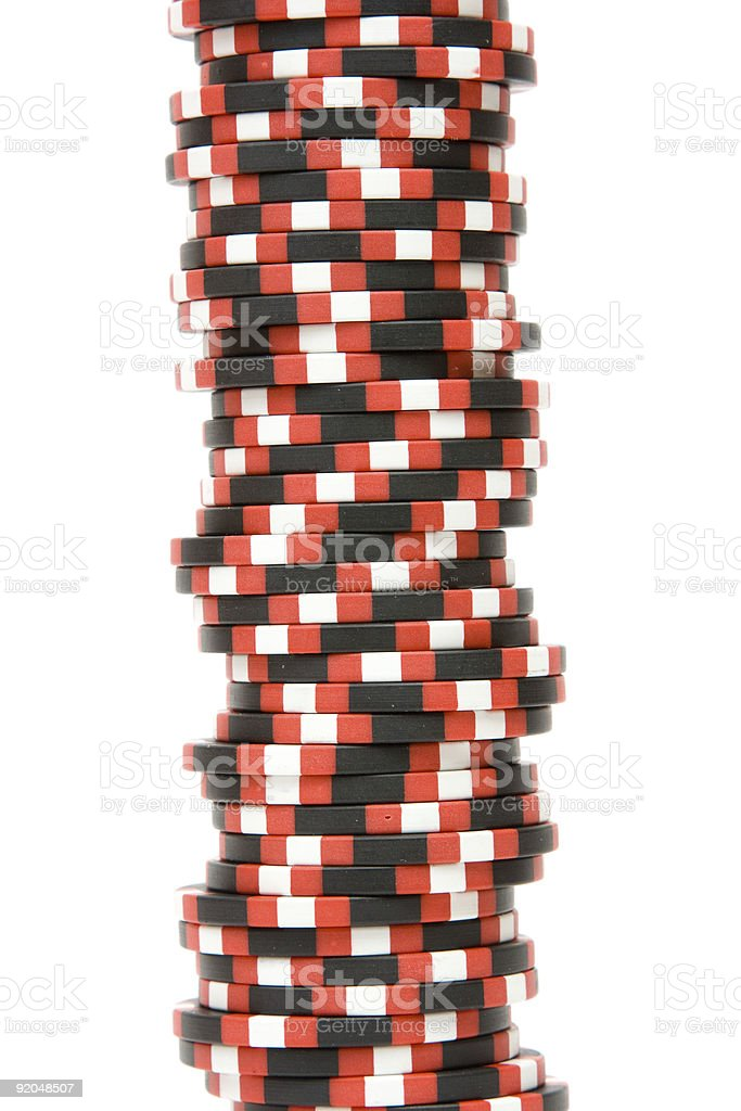 Stack of casino chips isolated over white background stock photo