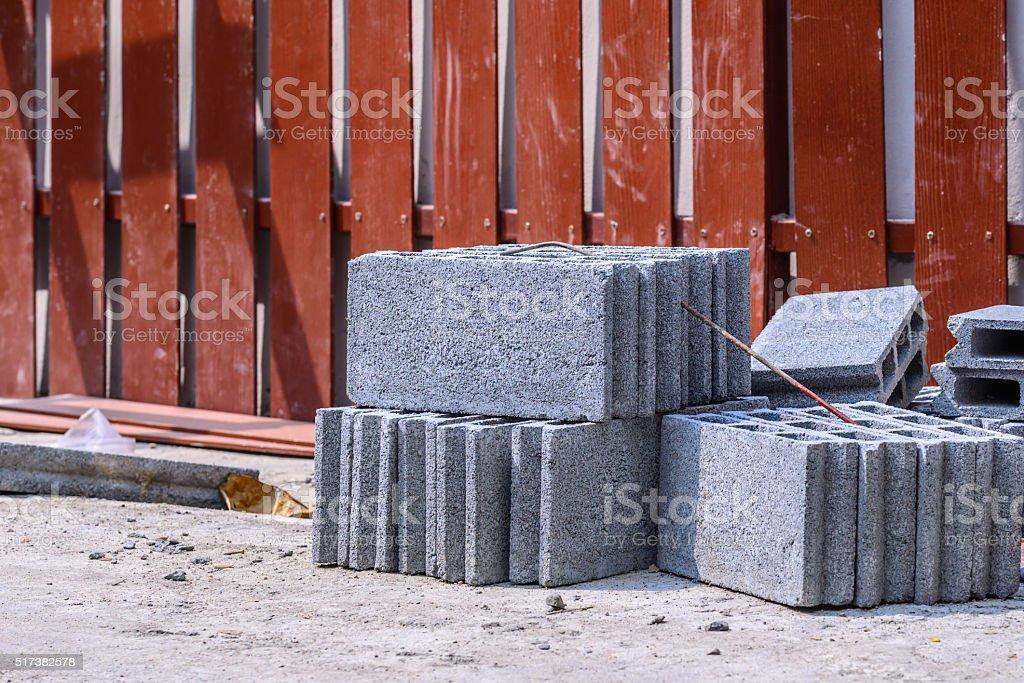 Stack of cement block brick at construction site. stock photo