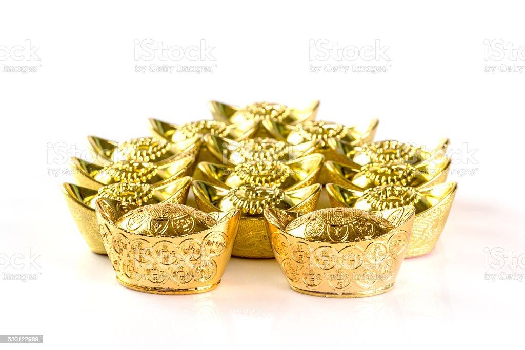 Stack of Chinese Gold Ingots on White stock photo