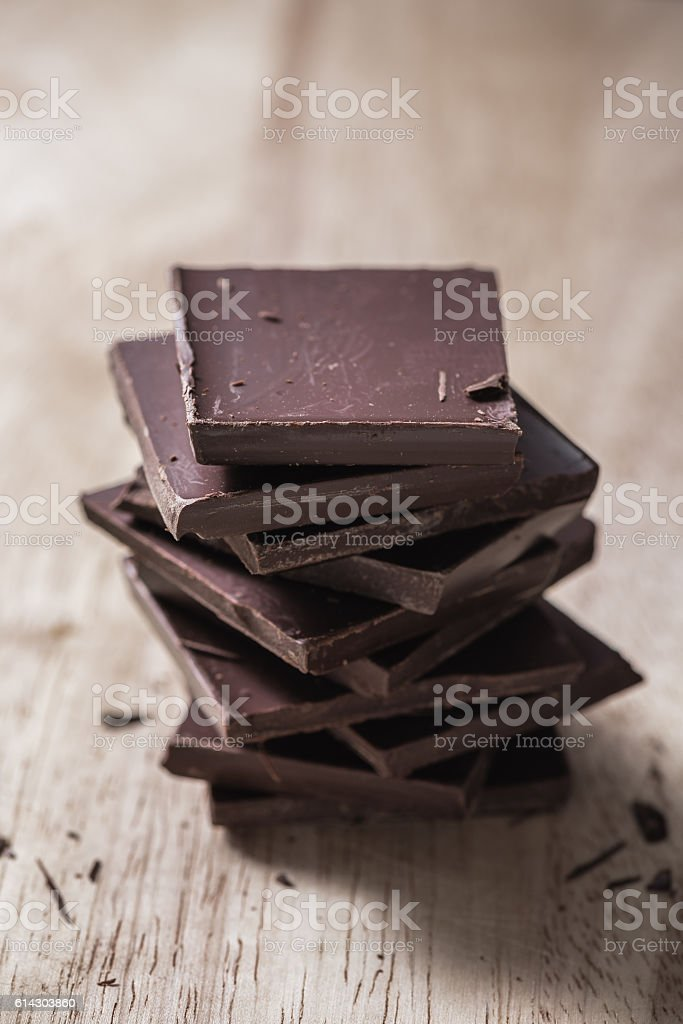 Stack of Chocolate Bars on Wooden Surface stock photo