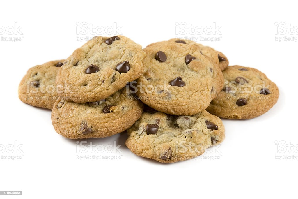 Stack of chocolate chip cookies on white background stock photo