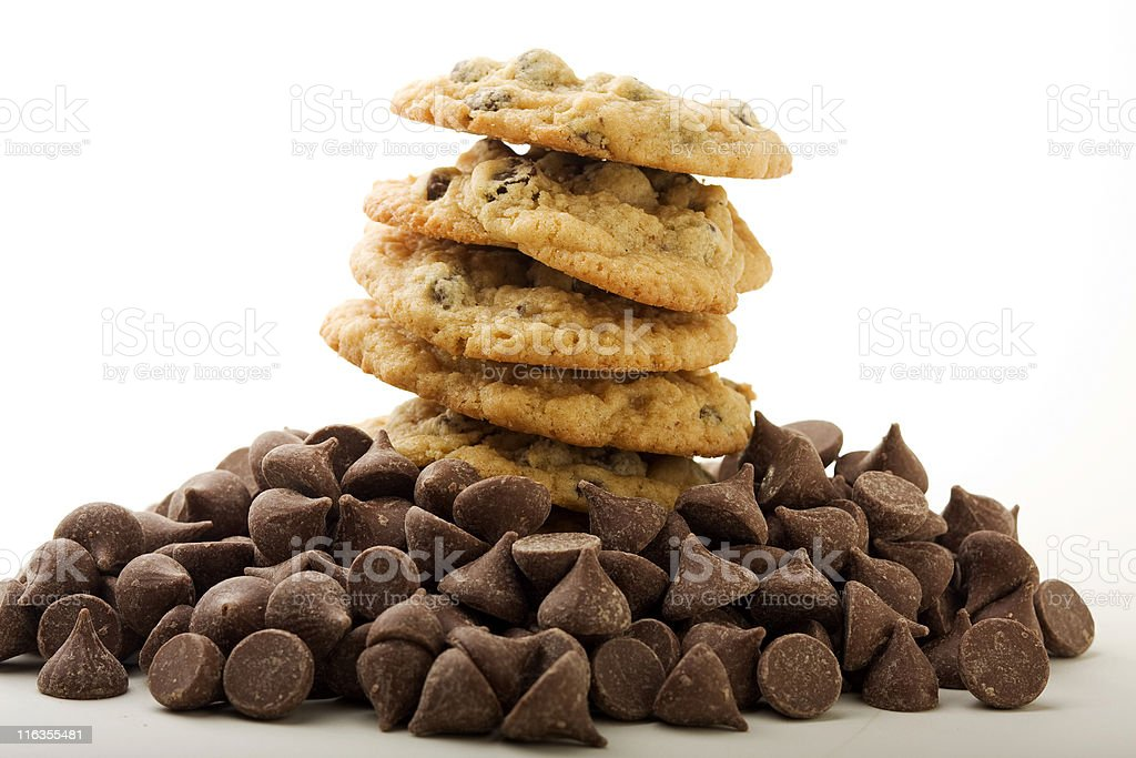 Stack of chocolate chip cookies with chocolate chips stock photo