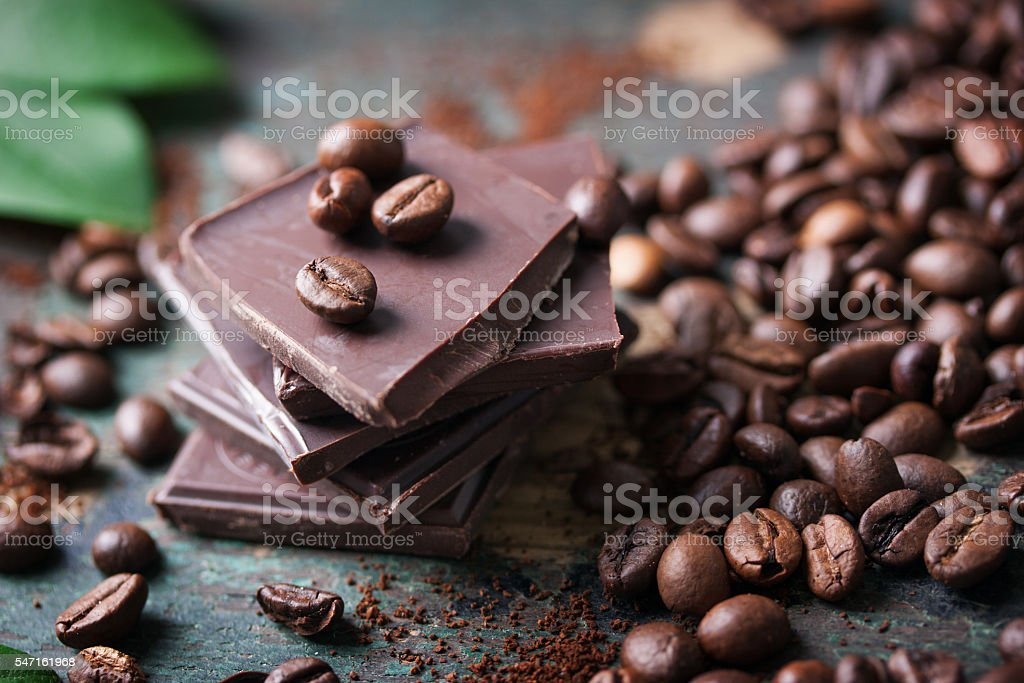 Stack of chocolate chunks with coffee beans stock photo