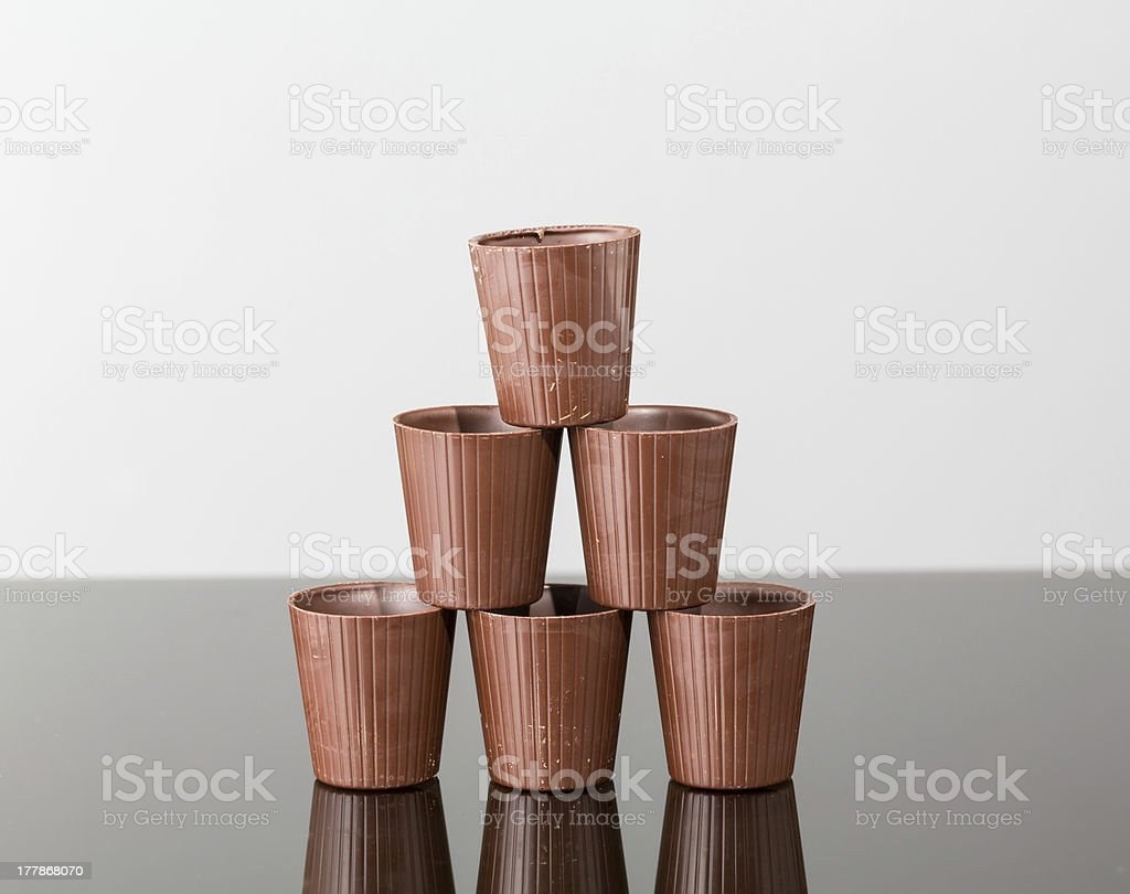 Stack of chocolate cups stock photo
