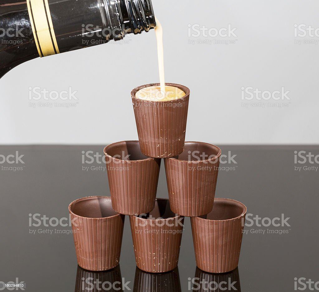 Stack of chocolate cups with liqueur stock photo