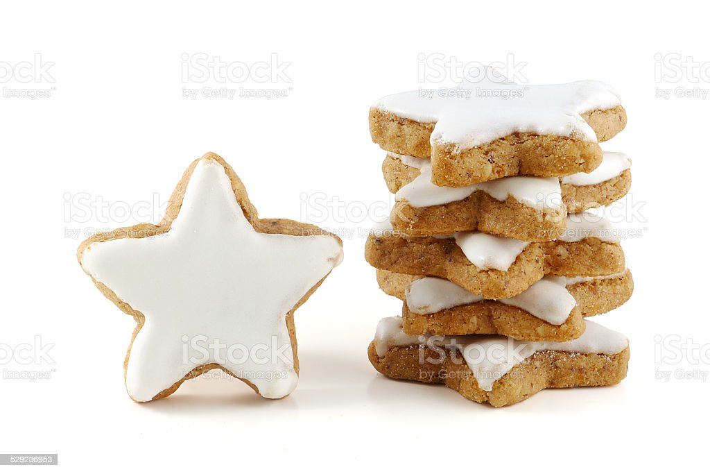 stack of cinnamon stars, one standing, cookies for christmas stock photo