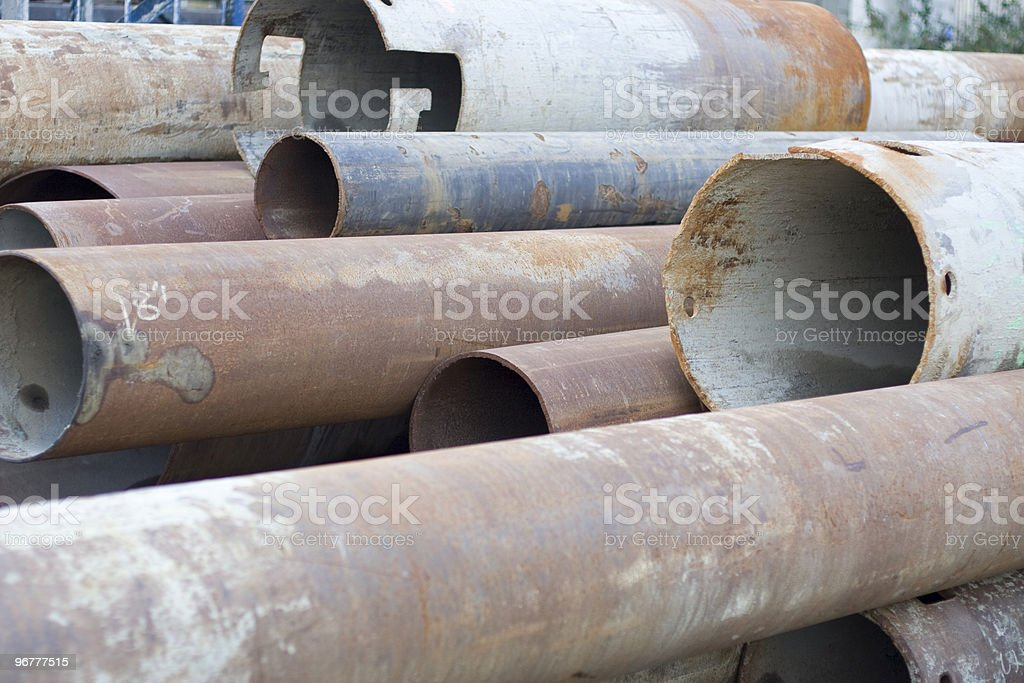 A stack of circular old rusty pipes of all sizes royalty-free stock photo
