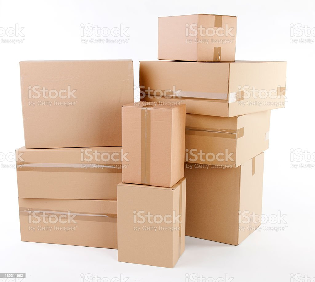 Stack of closed cardboard boxes on white background stock photo