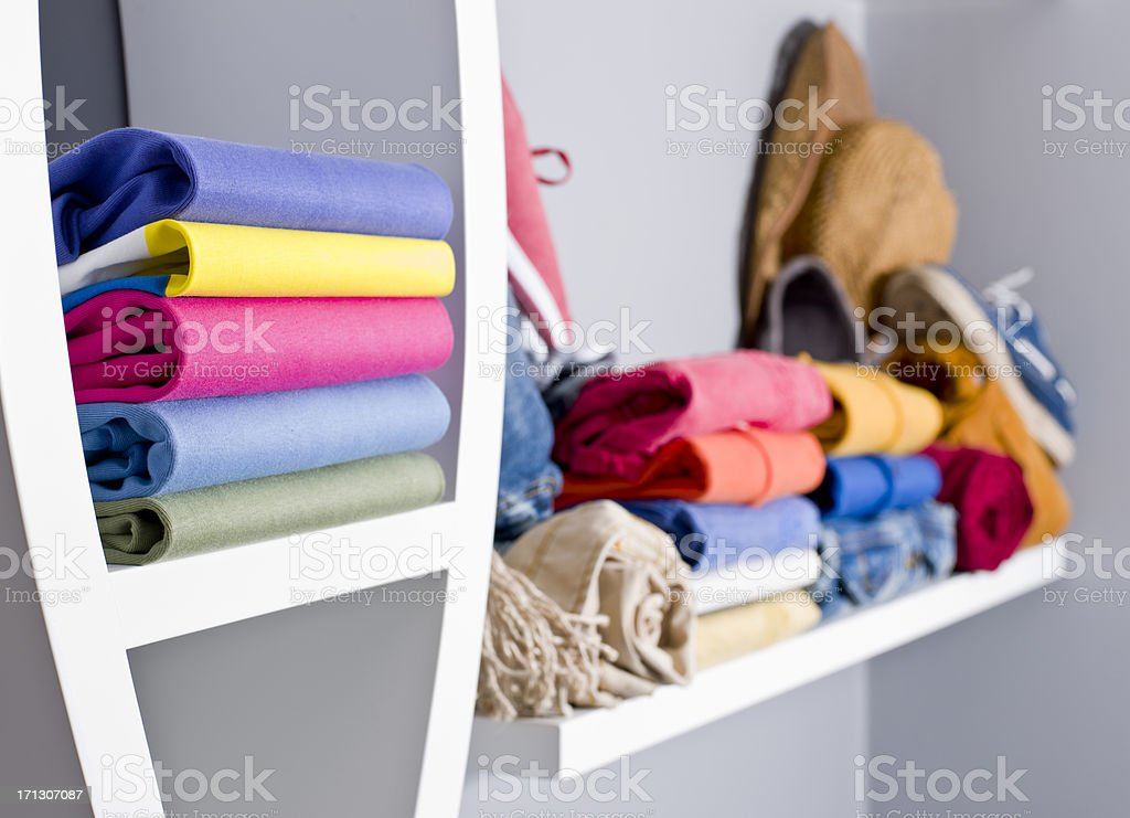 Stack of clothes and shoes on rack royalty-free stock photo
