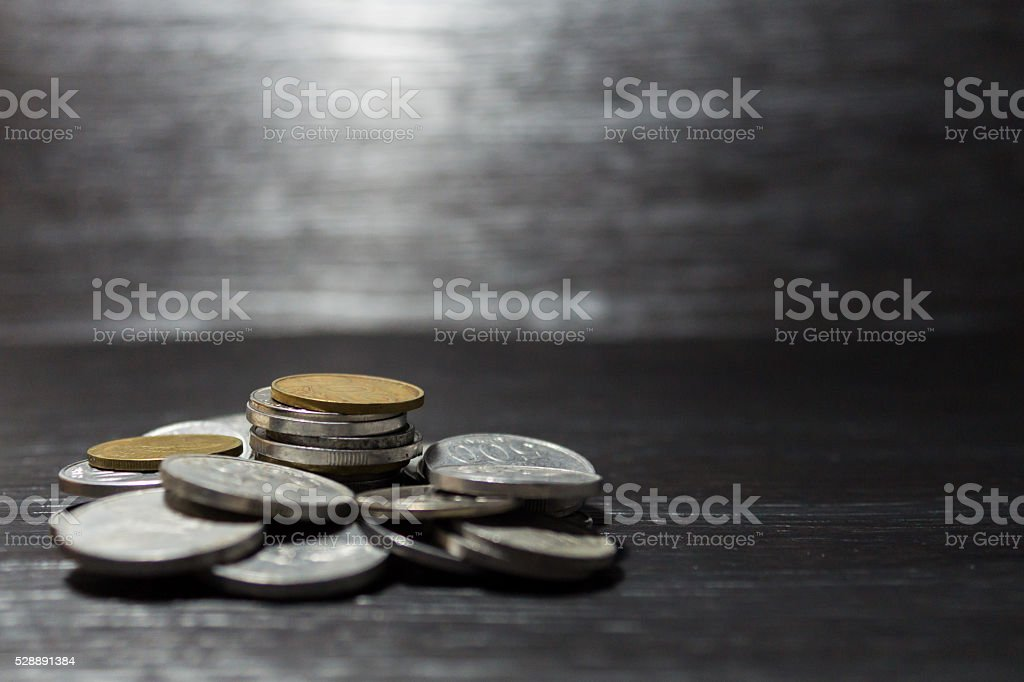 Stack of coin on wood pattern background stock photo