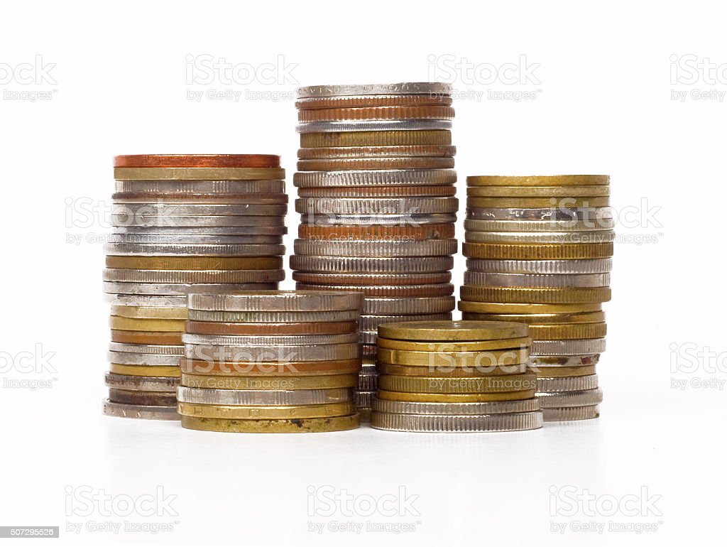 stack of coins isolated on white background stock photo