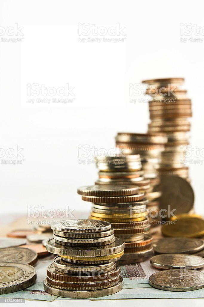 Stack of coins with bank notes isolated royalty-free stock photo