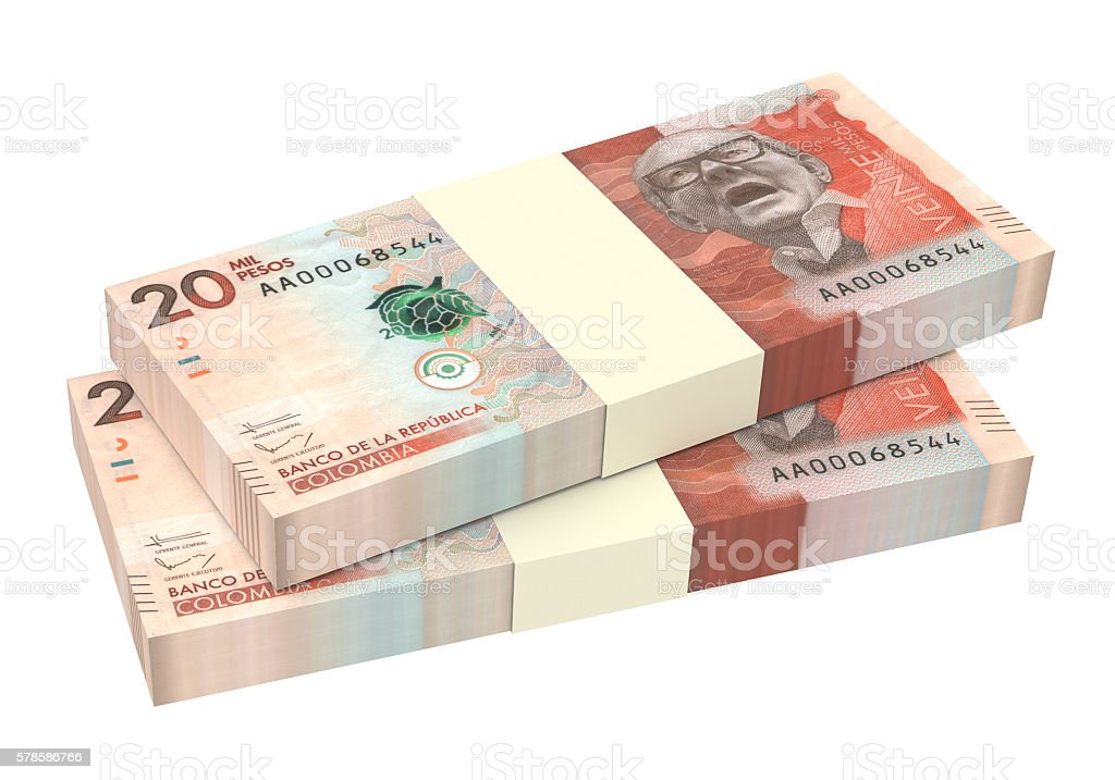 Stack of Colombian pesos bills isolated over white stock photo