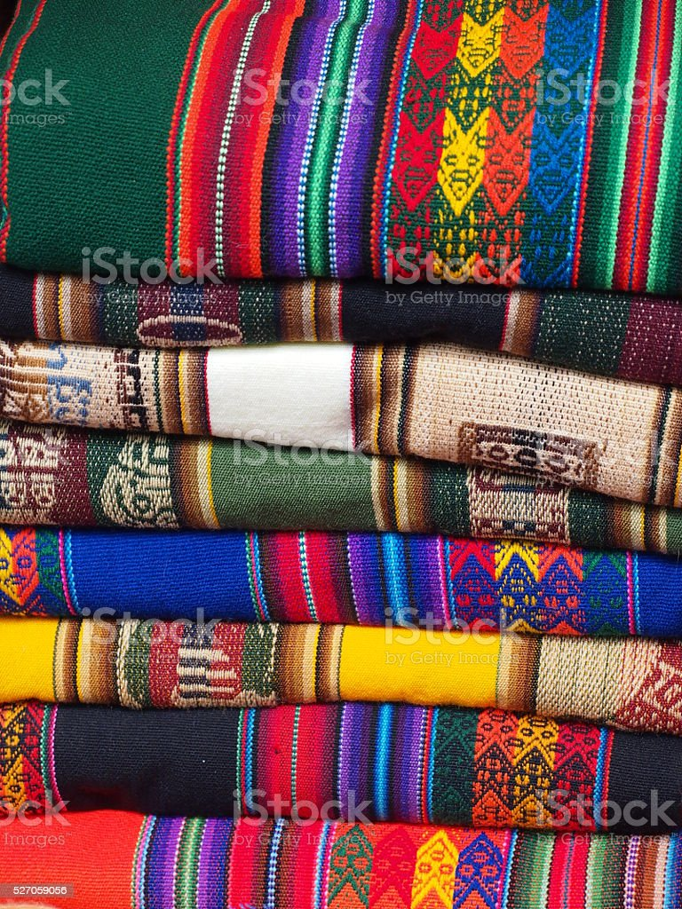 stack of colorful blankets stock photo   istock - stack of colorful blankets royaltyfree stock photo