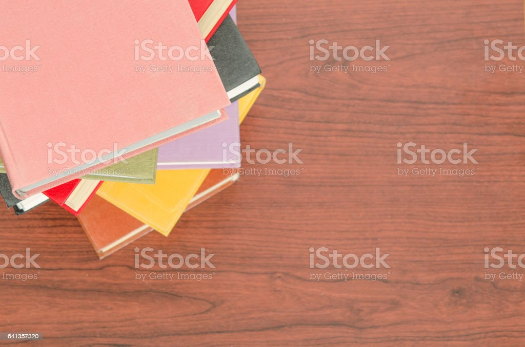 stack of colorful books in a library stock photo