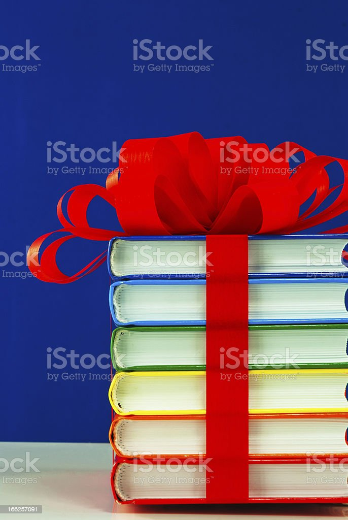 Stack of colorful books tied up with ribbon royalty-free stock photo