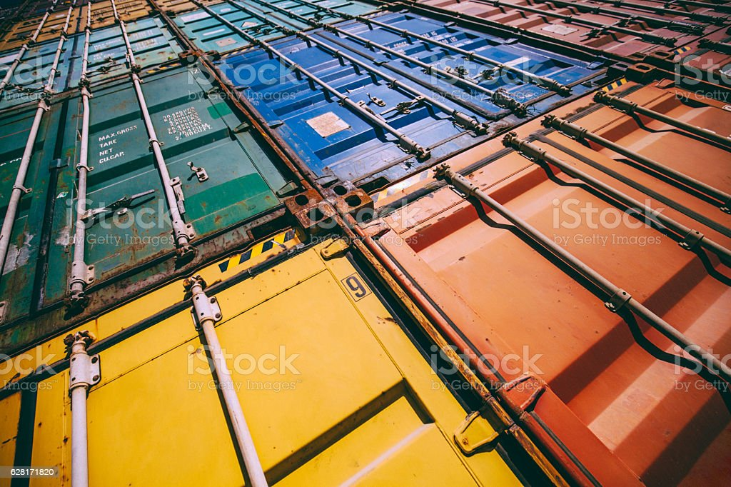 Stack of colorful cargo containers at the dock stock photo