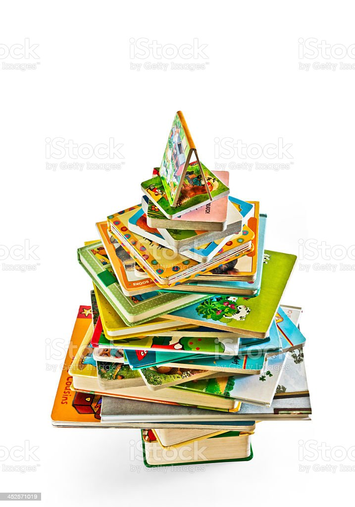 Stack of colorful children's books with one standing open stock photo