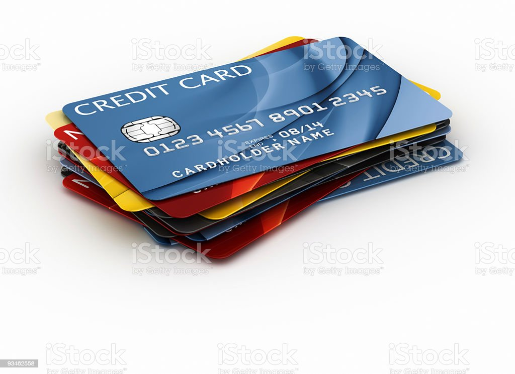 Stack of colorful credit cards against a white background stock photo