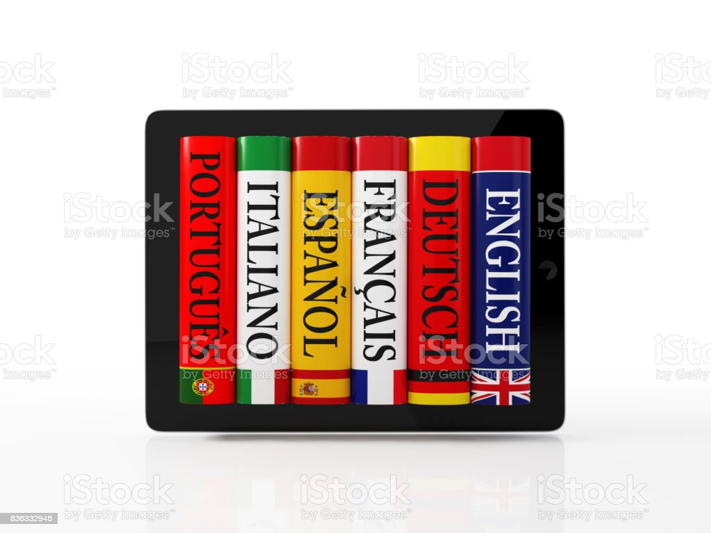Stack of Colorful Dictionaries on A Digital Tablet stock photo