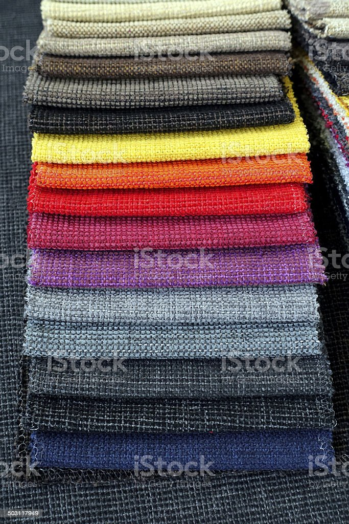 Stack of Colorful fabric texture samples stock photo