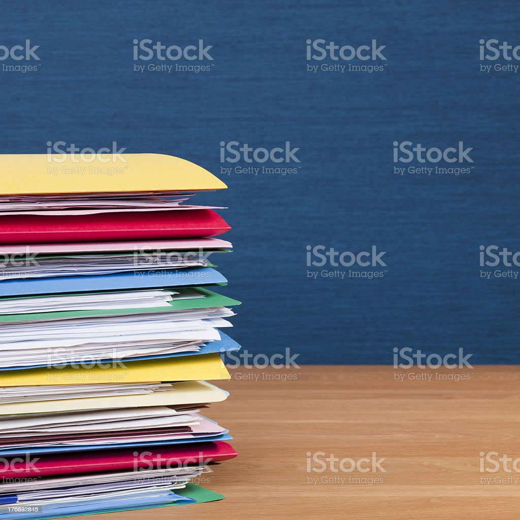 Stack of colorful file folders on wooden desk royalty-free stock photo