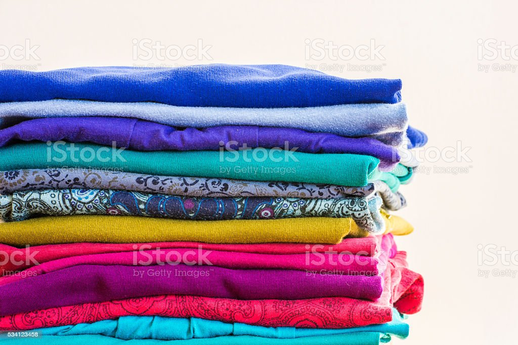 Stack of Colorful Knit Shirts stock photo