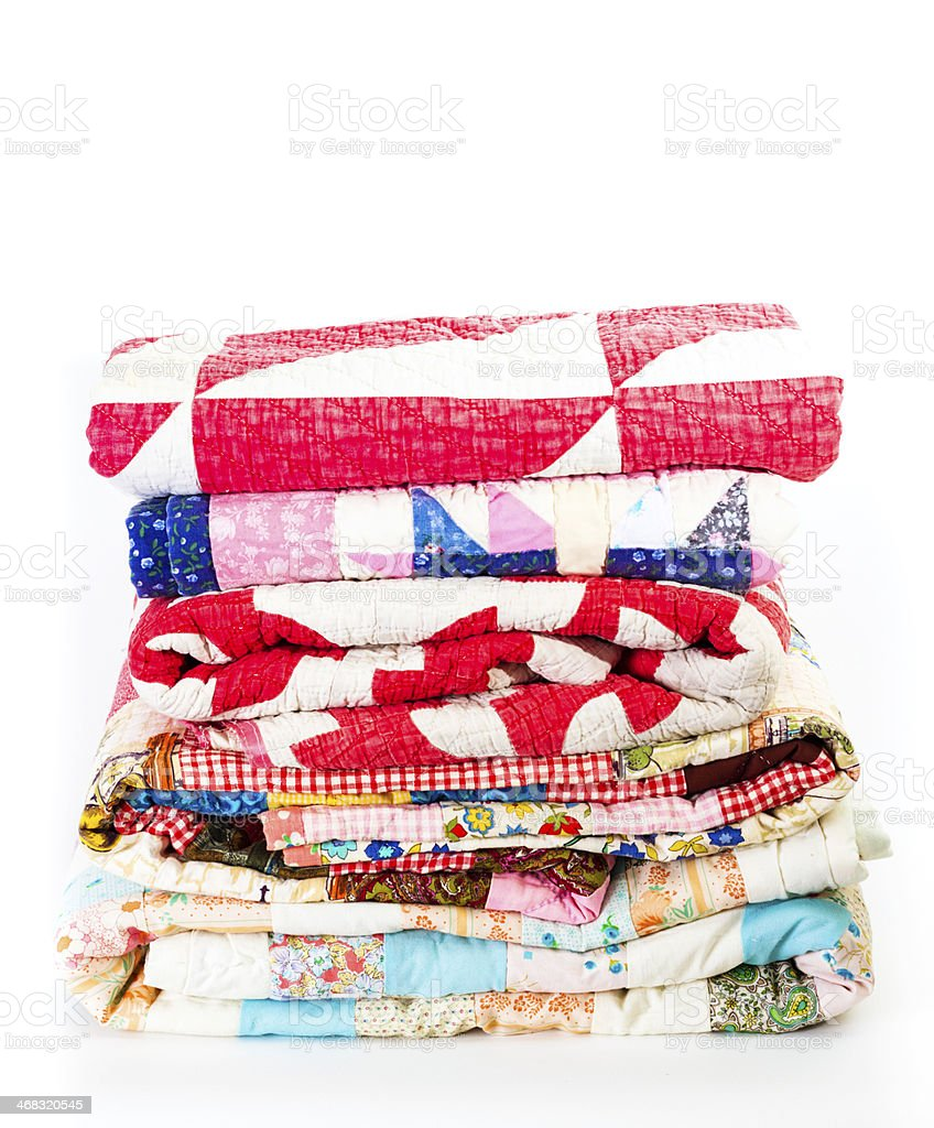 Stack Of Colorful Old Quilts stock photo