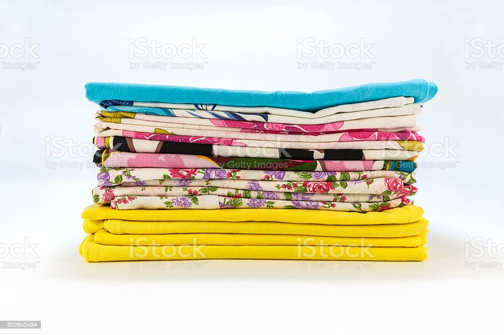 stack of colorful pillowcases over a white background stock photo