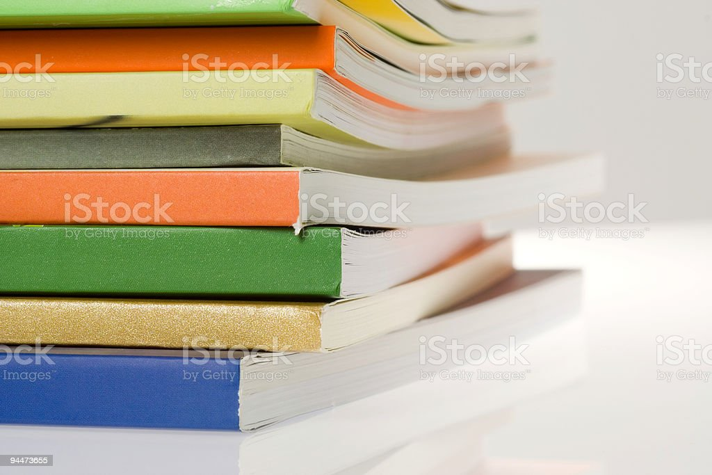 Stack of colorful softcover books royalty-free stock photo