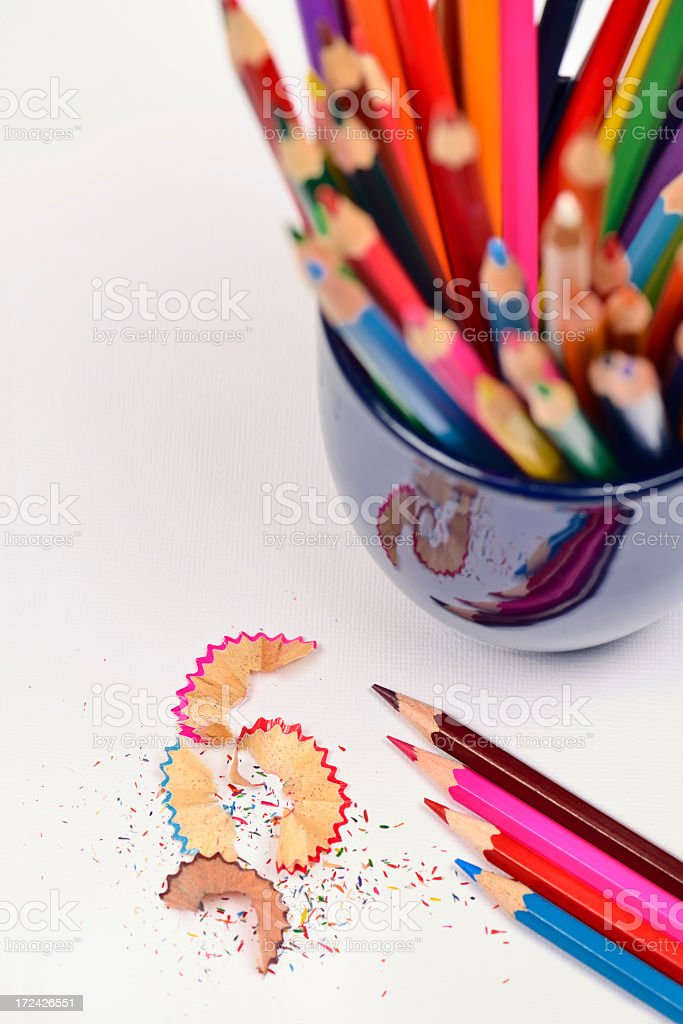 Stack of colour pencils and pencil shavings royalty-free stock photo