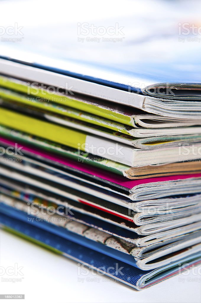 Stack of colourful magazines stock photo