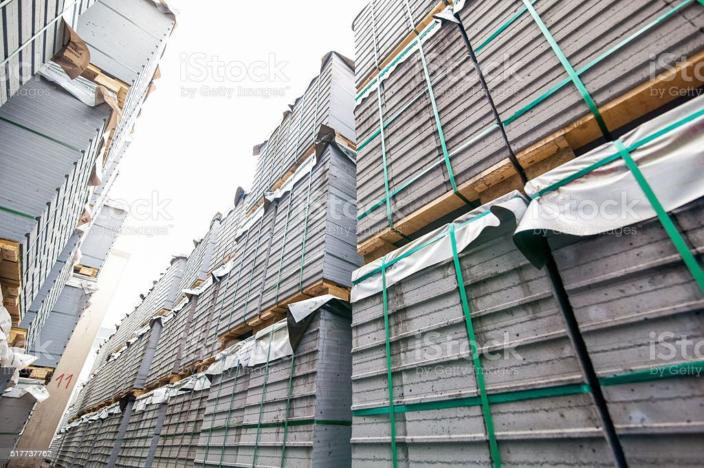 Stack of concrete blocks near house-building factory stock photo