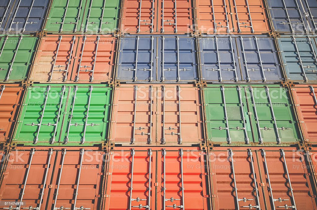 Stack of container shipping at dockyard area stock photo
