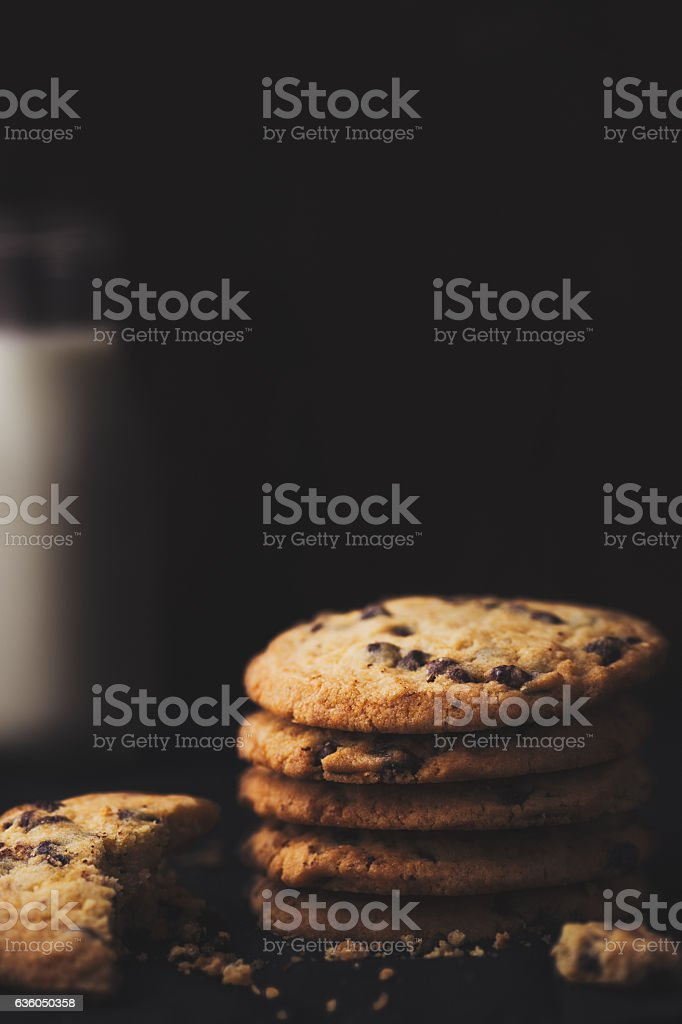 Stack of cookies and milk, dark food photography stock photo