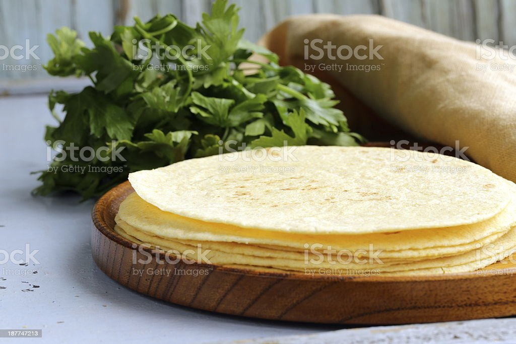 stack of corn tortillas on a wooden plate stock photo