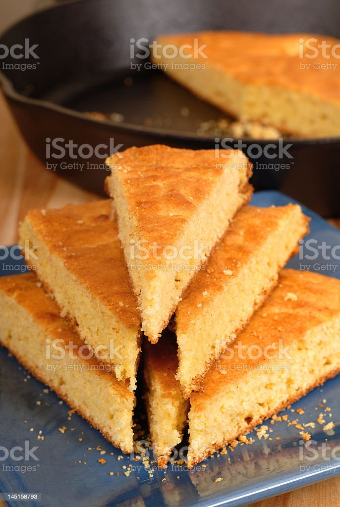 Stack of cornbread on blue plate stock photo