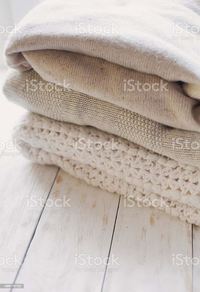 Stack of cozy knitted sweaters stock photo