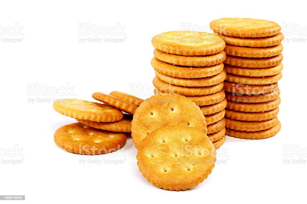 Stack of cracker biscuits on a white background. stock photo