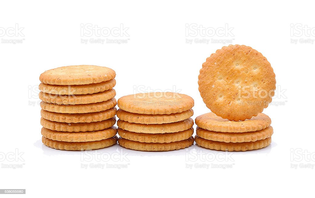 stack of crackers on white background stock photo
