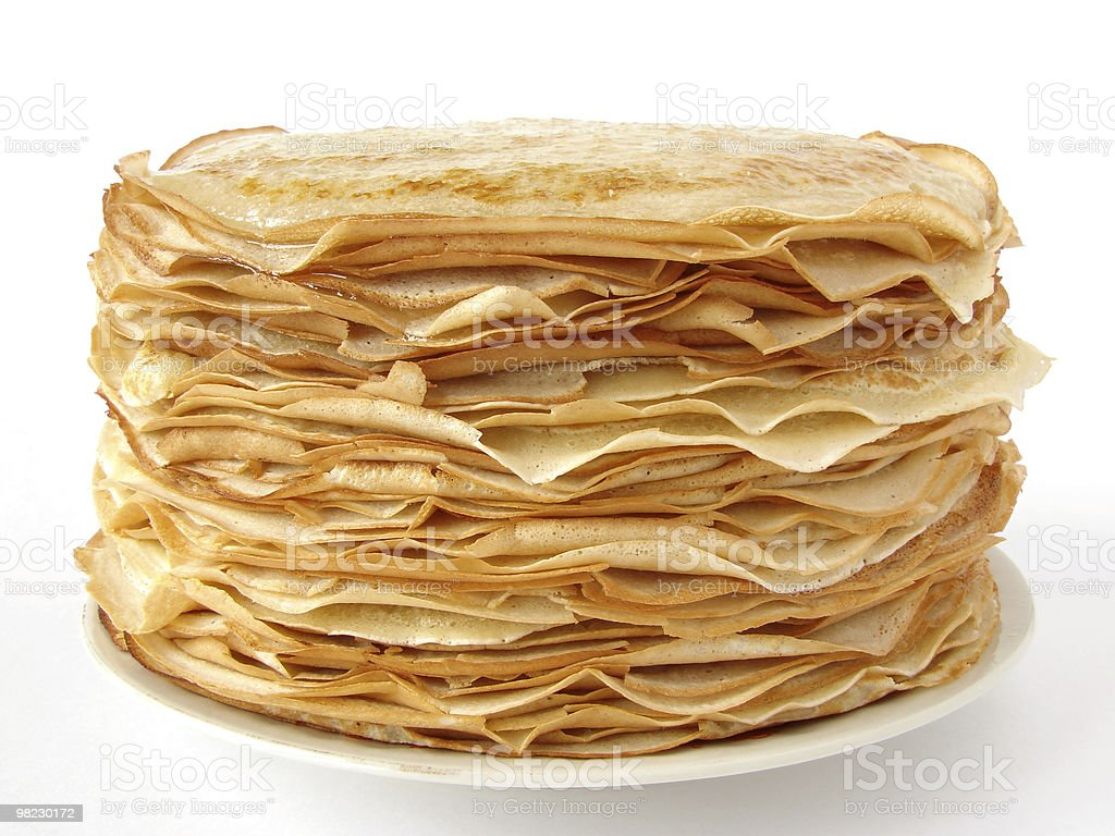 A stack of crepe pancakes on a white plate stock photo