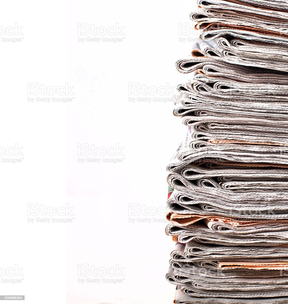 stack of daily newspapers stock photo