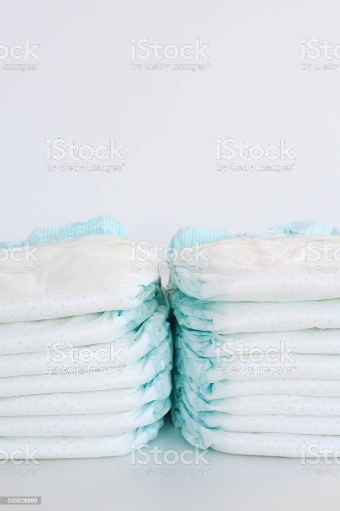 Stack of diapers isolated on white background stock photo