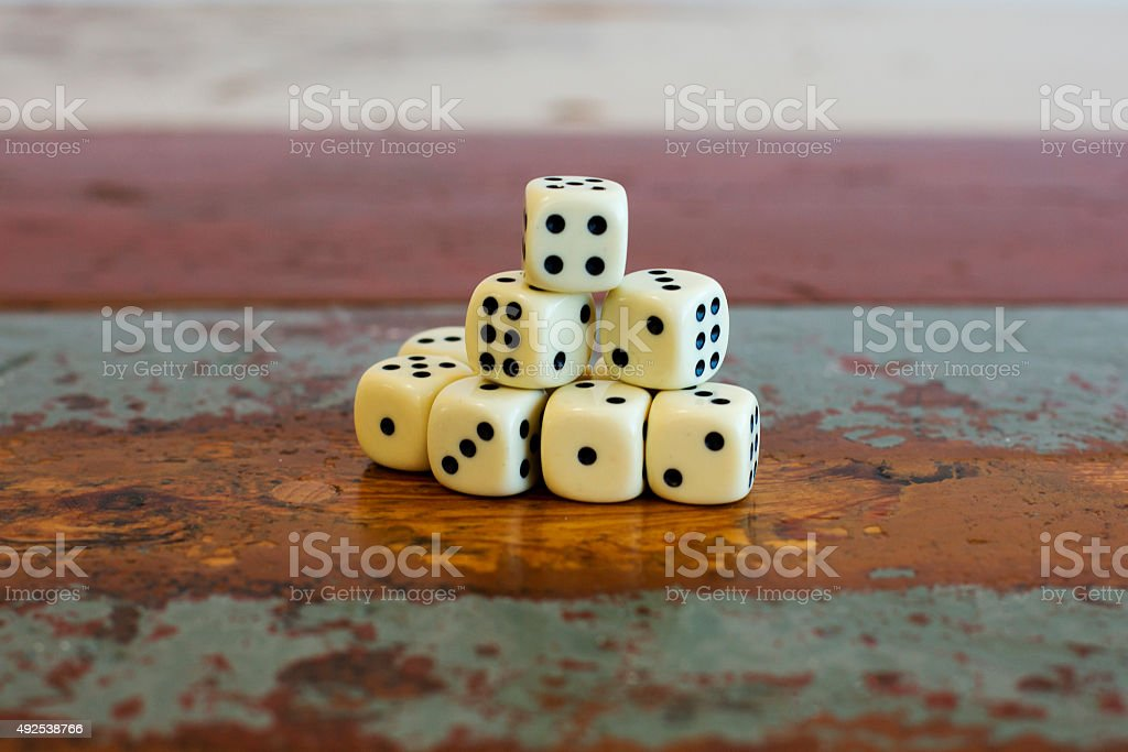stack of dice on table stock photo