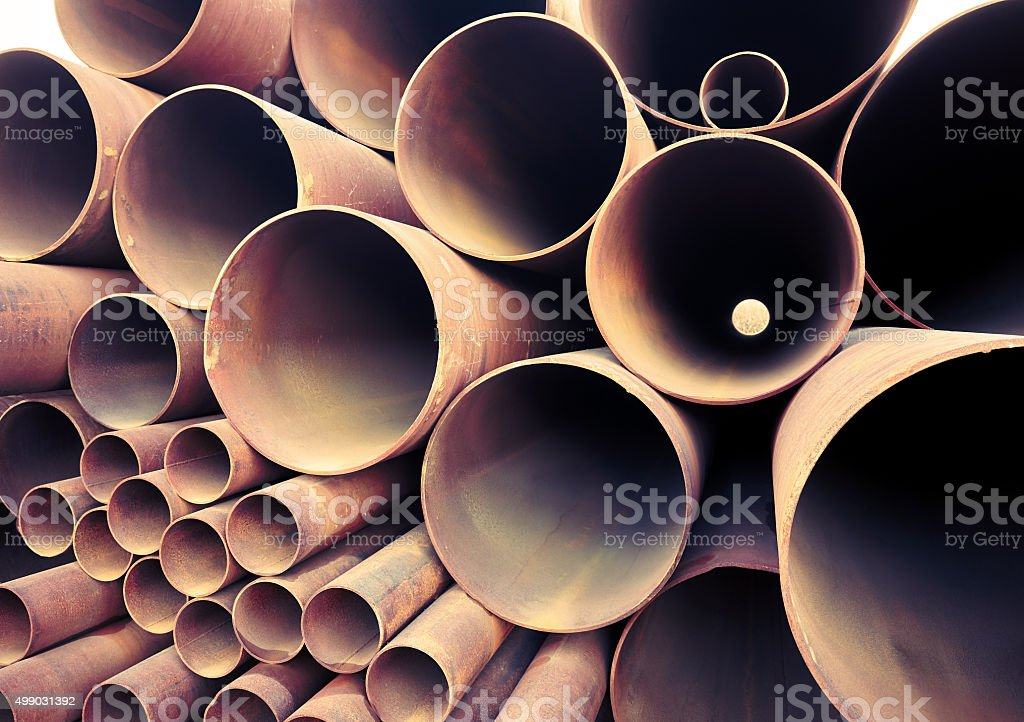 stack of different old rusty pipes stock photo